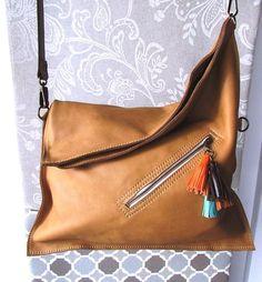 Leather crossbody bag, Foldover bag, Everyday purse, Camel crossbody purse on… Crossbody Bags For Travel, Leather Crossbody Bag, Leather Handbags, Leather Purses, Leather Tassel, Tan Leather, Couture Cuir, Foldover Bag, Kelly Bag