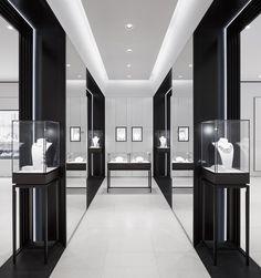 Minimalist jewelry display in master closet.