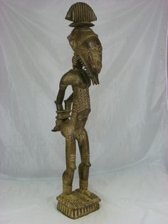 """Superb Old African Tribal Art, Baule Slave Ancestor Figure    Dimension: 37""""H  x  6 1/2"""" x  11""""  Early-Mid 20th Century  Conditions: Wood deterioration, age cracks, chips and scrapes, overall condition good.  If you want more pictures just let me know.    FREE SHIPPING WORLDWIDE !      Among the Baule peoples of Côte d'Ivoire, human experienceevolves out of and remains inextricably linked to the  ancestral spirit world, or blolo (roughly, """"the village of truth""""),which controls and determines…"""