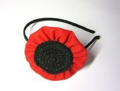 Colourful poppy headband made of cotton fabric and acrylic/cotton yarn. Embellished with green beads. The flower measures approximately 3 3/4 inches / 9.5 cm. $16.5 via Etsy.
