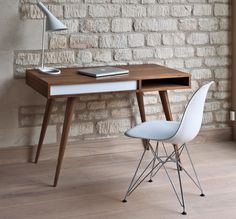 A simple mid-century design with today's simple workspaces in mind, the Celine Desk by Nazanin Kamali is easy on the eyes and easy to assemble. This desk is available in oak and walnut, each featuring the distinctive white panel and a convenient cubby in which to store your laptop or important papers.