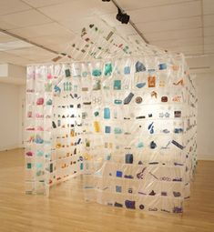 Work in art quilts, installation with found objects, fiber art.