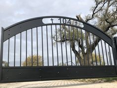 Our latest driveway gate is matte black and personalized with the house number and crosses in a traditional arched shape. Iron Gate Design, Security Gates, Automatic Gate, Driveway Gate, My Property, Entrance Gates, Iron Gates, Modern Traditional, House Numbers