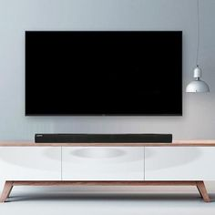 The soundbar also includes wall-mounted support.