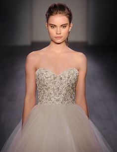 Champagne tulle bridal ball gown, strapless sweetheart neckline, pearl and rhinestone encrusted bodice, natural waist, circular tulle skirt with layered horsehair, chapel train. Also available in Ivory.