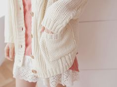 I really like this comfy combination with the peach top, creme cardigan, and the white skirt.