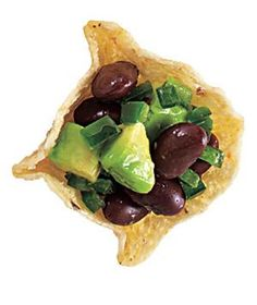 Scoopable tortilla chips are the perfect vehicle for a mixture of black beans, diced avocado, and minced jalapeño.