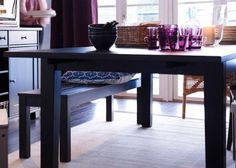 Love the black bench with patterned cushion, and purple glasses