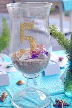Loving these gorgeous mermaid centerpieces! They look amazing at a table! See more party ideas and share yours at CatchMyParty.com