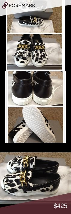 NWT GIUSEPPE ZANOTTI calf hair slip-on sneakers new with dust bag and box Made in Italy.   size: 35(IT) White rubber sole measures approximately 25mm/ 1 inch Black and cream printed calf hair Gold chain embellishment, fringe, black leather trims, round toe Slip on Giuseppe Zanotti Shoes Flats & Loafers