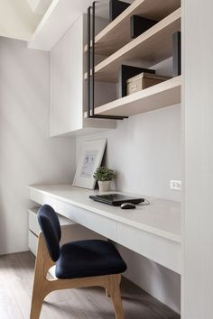 Contemporary Home Office with Hardwood floors, Built-in bookshelf, High ceiling