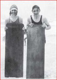 Agatha Christie and a young naval attaché named Ashby stand on Muizenberg Beach, South Africa, following surf bathing, Jan.-March 1922