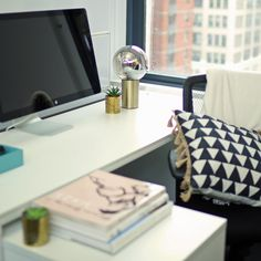 7 Ways to Make Your Work Desk Feel More Like Home: Let's face it: no one wants to live at their desk, but it's necessary to spend some time there if you want to keep your job.