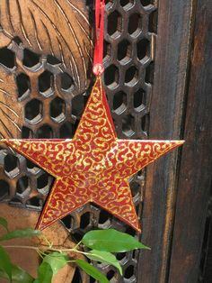 Large red metal star with hand painted gold decoration. http://www.maroque.co.uk/showitem.aspx?id=ENT04354&p=06506&n=all
