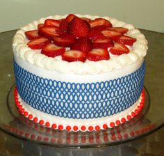 July 4th cake with fresh strawberry cream, covered with fondant and edible lace.