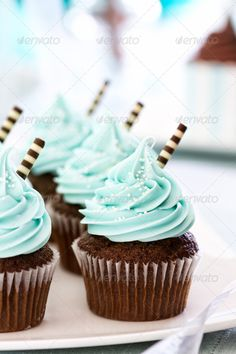 The chocolate cupcakes are easy to make but really have impact. I would never ha… The chocolate cupcakes are easy to make but really have impact. I would never have guessed that the striped chocolate sticks would work with… Baby Shower Cupcakes For Boy, Gateau Baby Shower, Cupcakes For Boys, Baby Shower Desserts, Baby Shower Cakes, Shower Baby, Baby Showers, Cupcakes Au Cholocat, Chocolate Cupcakes