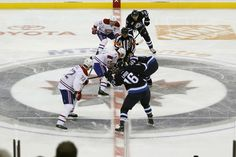 The referee drops the puck for the opening face-off between the Winnipeg Jets and the Montreal Canadiens during first-period NHL hockey action in the Jets' inaugural home game at the MTS Centre in Winnipeg, Manitoba, Sunday, Oct. Jets Hockey, Hockey Games, First Period, Hockey Stuff, Referee, Face Off, Montreal Canadiens, Nhl, Centre