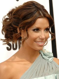 Loose Tresses Eva Longoria proves that tamed tendrils can help emphasize features and soften more structured updos.