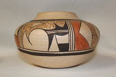 "Native American Hopi Pottery 58. Description: Ca. 1960's, Beautiful poly chrome pottery jar with classic geometric motif. Very good condition. 4-1/2"" x 7"". ""Stella Huma was one of the finest potters o"