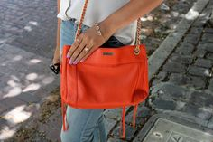 Britt + Whit: Britt's bright orange Rebecca Minkoff bag!