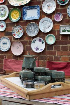 An outside wall of plates...