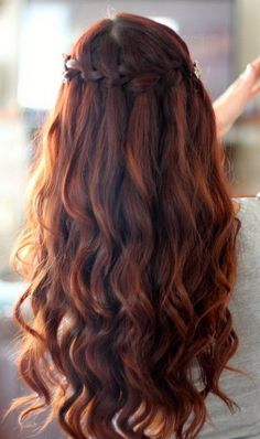 homecoming  braided hairstyles | waterfall braid with spiral curls prom hairstyles