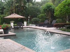 Traditional Swimming Pool with exterior brick floors