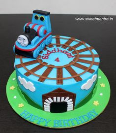 Thomas train theme customized designer fondant cake with 3D thomas topper for boy's birthday at Pune