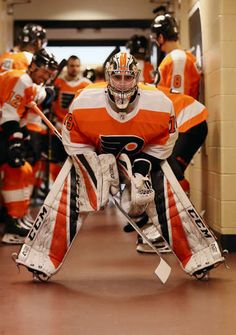 PHILADELPHIA, PA - DECEMBER Carter Hart of the Philadelphia Flyers prepares to lead his team onto the ice for warmups prior to his game against the Detroit Red Wings on December 2018 at the Wells Fargo Center in Philadelphia, Pennsylvania. Hot Hockey Players, Flyers Hockey, Ice Hockey Teams, Hockey Goalie, Nhl Players, Field Hockey, Nhl Wallpaper, Washington Capitals Hockey, Hockey Boards