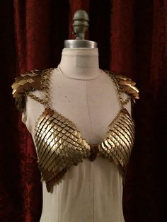 Just cant get enough scales? Why bother wearing a shirt? This eye-catching piece is perfect for your next LARP, performance, club night -- or even