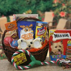Faithful Friend  Pet Gift Basket - Dog    Whether they've just learned to sit or mastered potty training, reward that special pooch with an outstanding collection of doggie treats. Our Faithful Friend Dog Gift Basket arrives stuffed with Milk-Bone treats, Snausages dog treats, chew bone, Canine carry out treats, pastel rope toy with hand grip, 2 rubber soft spike balls, and for those precious moments to be remembered fur-ever, a Pawprint Picture Frame.