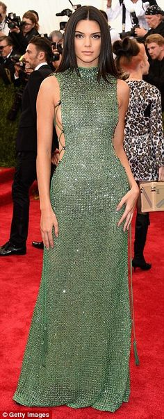 Ooh la la: Kendall Jenner skipped the theme in favour of a very racy green Calvin Klein nu...