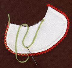 Introduce another color change the appearance of this basic trim by whipping strands of floss around the rick-rack. Made by Trudy Horne.