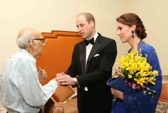 Prince William, Duke of Cambridge and Catherine, Duchess of Cambridge speak with Boman Kohinoor during a meeting in Mumbai on April 10, 2016. Kohinoor, 93, has a strong claim to be India's biggest fan of the British royal family.