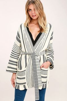 The Annual Ritual Black and White Striped Cardigan Sweater is giving us a reason to celebrate all year 'round! Cozy knit fabric forms this striped cardigan sweater with a collarless neckline, long sleeves, and a relaxed bodice with front patch pockets. Wear open or use included sash to cinch at the waist!