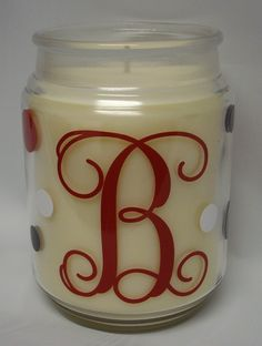 Michael's has decent candles that go on sale for around 2 for $5 this time of year. The label soaks off easily. I like to tie ribbons around the jar lid.