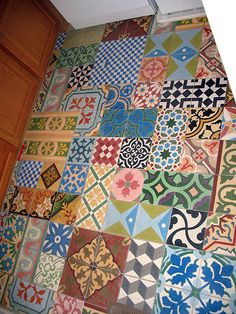 patchwork tile floor--wouldn't use it in a large room--but I can't help but love it!