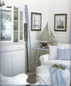Nautical style doesn't always require the traditional navy, red and yellow colors. Here's an example of a Nautical style using soft blues and white with weathered wood accents.