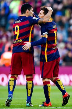 Lionel Messi (R) of FC Barcelona is congratulated by his teammate Luis Suarez after scoring his team's second goal during the La Liga match between FC Barcelona and Granada CF at Camp Nou on January 9, 2016 in Barcelona, Catalonia.