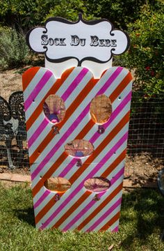 hot pink and orange cirque du bebe French circus themed baby shower carnival sock throw game