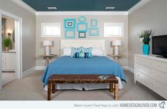 Ideas for Blue Contemporary Bedrooms | Home Design Lover.  Greg Riegler Photography Those frames on the all are super cute! This bedroom has a blue ceiling that is deeper teal looking super crisp framed by the white ceiling trim.