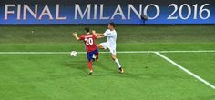 Atletico Madrid's Spanish defender Juanfran vies for the ball against Real Madrid's Portuguese forward Cristiano Ronaldo during the UEFA Champions League final football match between Real Madrid and Atletico Madrid at San Siro Stadium in Milan, on May 28, 2016.