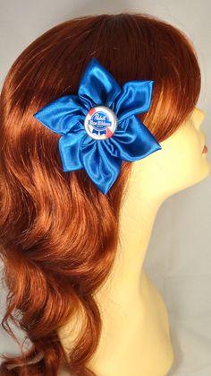 PBR Pabst Bottle Cap Blue Satin Pinup Rockabilly Hair Flower. $15.00, via Etsy.