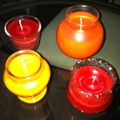 Homemade candles. The two lighter oranges are soy the other two are plain wax