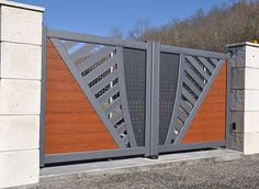 The gate design is a very important moment in the process of designing the fence of a backyard plot or a private house. After all, the gate. Iron Main Gate Design, Home Gate Design, Grill Gate Design, House Main Gates Design, Fence Design, Gate Designs Modern, Modern Gates, Modern Front Gate Design, House Front Gate