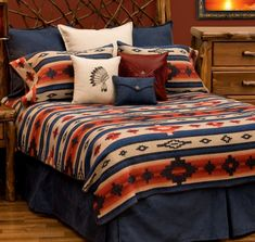 The Redrock Canyon bedding collection by Wooded River offers vibrant colors of navy blue, tan, dark reds and orange in a bold southwest design and complimenting accents to create a great looking Southwestern Bedroom. Authorized wooded river retailer