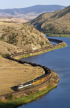 Curving coal - BNSF coal train for Roberts Bank, BC, curves along the Missouri River in Lombard Canyon Rail Train, Train Car, Train Tracks, Locomotive, Old Steam Train, Bnsf Railway, Railroad Pictures, Rail Transport, Missouri River