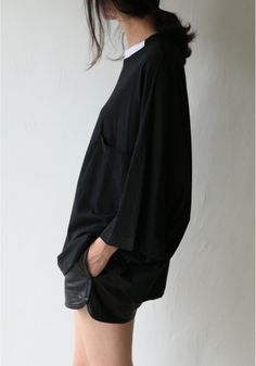 white button down, black sweater/tee, black shorts/skirt