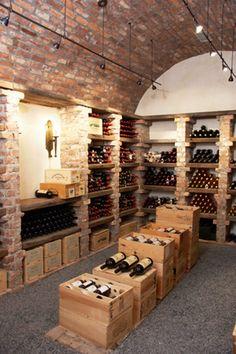 Subway-style brick cellar with wine crate storage in the center Cave A Vin Design, Bodega Bar, Wine Cellar Basement, Home Wine Cellars, Wine Cellar Design, Interior Design Portfolios, Wine House, Rustic Basement, Italian Wine