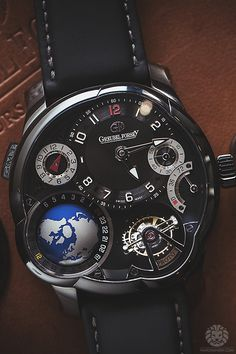 We take a look at the Greubel Forsey Tourbillon 24° Incline   GMT Black. 9656f802f5c